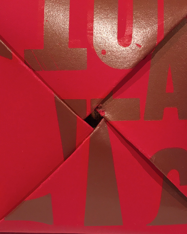 Detail image from TAKING birth CONTROL campaign (2018) - red paper folded with metallic printed letter fragments